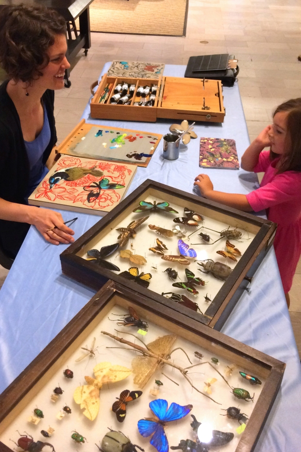 """Ashley Cecil working on """"Blue-faced Honey Eater on Taupe"""" at the Carnegie Museum of Natural History. Photo by Gregg Valley."""